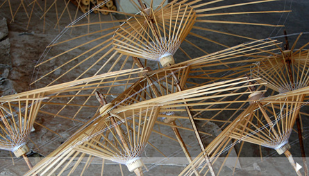 Umbrella frames at a small umbrella factory in Chiang Mai. Photo by Flickr user Distra.
